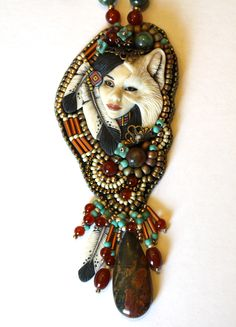 Shape shifter by Amy Johnson Designs. Porcelain cabochon by Laura Mears.