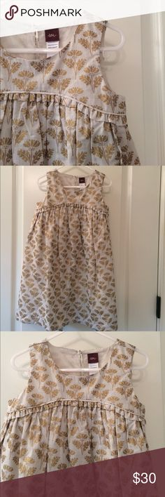 NWOT Tea gold patterned dress. So pretty! NWOT Tea gold patterned dress. So pretty! Never worn. It's super pretty, not my style. Gold leaves on scream-ish background. The fabric is excellent quality size 4. Tea Dresses Formal