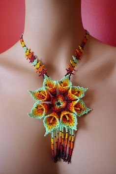 Huichol necklace, with multicolor small beads, big flower design! Seed Bead Flowers, Beaded Flowers, Bead Embroidery Jewelry, Beaded Embroidery, Bead Loom Patterns, Beading Patterns, Beaded Necklace Patterns, Handmade Beaded Jewelry, Seed Bead Jewelry