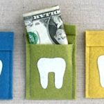 Simple felt pouch with a tooth applique on front (fusible webbing), large enough to hold a small toy or folded money. Free template available via pdf download.