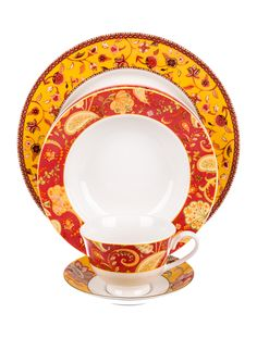 Red, yellow and multicolor ceramic Neiman Marcus Provence table settings comprising four dinner plates, four salad plates, four bowls and four cups and saucers with floral motif throughout and brand stamp at undersides.
