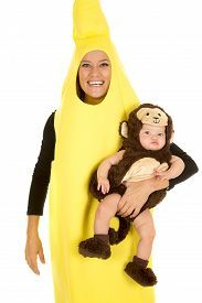 stock photo of baby monkey a mom in her banana costume with a smile - Halloween Monkey Costumes