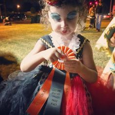 "A sweet photo of a first time winner and a wonderful customer testimonial! ""Your ribbons are beautiful and so well crafted! The one my girls received tonight is the first ribbon they have ever gotten in a contest. They have displayed next to their bed on a picture frame. We will be keeping it forever! Thank you!"" ~Marisa Nicole Sertic"