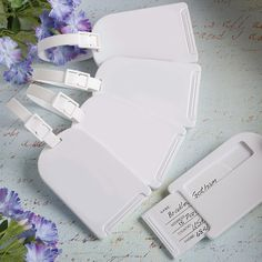 Perfectly Plain Collection Luggage Tag Favors (FashionCraft 6722) | Buy at Wedding Favors Unlimited (http://www.weddingfavorsunlimited.com/perfectly_plain_collection_luggage_tag_favors.html).