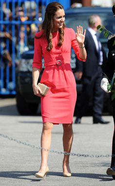 Kate Middleton kept it modest yet stylish in a salmon-pink Goat sheath during a visit to a London school.