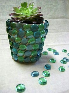 Hot glue some beads, marbles (you can find these in the craft or fish section at Walmart) or use broken stone pieces to create a unique planter pot. G;)