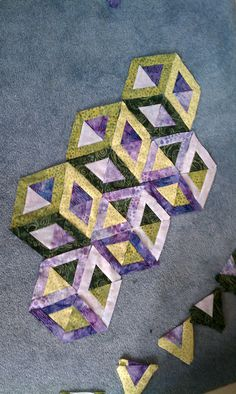 3-D hollow cubes with forced perspective made entirely from little triangles.