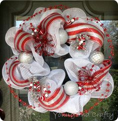 Deco mesh Christmas wreath. Use this link: http://www.youngandcrafty.com/2011/12/deco-mesh-christmas-wreath.html