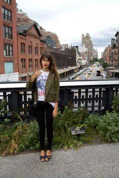 Jeanne Damas: graphic tee + army jacket + black skinny jeans