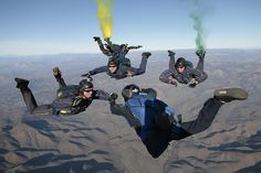 The U.S. Navy parachute demonstration team administers the oath of enlistment during a free fall jump.  by Official U.S. Navy Imagery, via Flickr