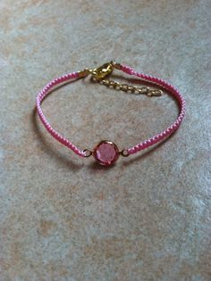 pink macrame bracelet with a gold framed pink glass by asiako25, $10.00