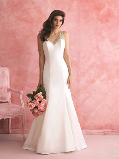 This gorgeous Allure Bridals sheath dress features a gorgeous and unique  racer-back which is 781fc0304a