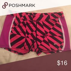 NWOT Nike shorts Abstract pink spandex Dri-Fit Nike shorts. New without tags, never worn. Smoke free home. Super cute! Nike Shorts