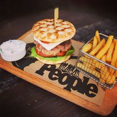 Delicious homemade burger on warm pitta bread with tzatziki, feta cheese and roasted red pepper. Sharing Platters, Pizza And More, Homemade Burgers, Greek Dishes, Pitta, Roasted Red Peppers, Snack Bar, Tzatziki, Rhodes