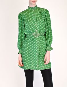 """Jean Muir London, 1970s, Green Geometric Button Up Tunic Dress - from Amarcord Vintage Fashion. """"Vivid green silk w/ grey geometric pattern throughout. Sitch details along collar, shoulders, and cuffs. Plastic button up front with matching fabric belt, lucite buckle. Pockets at hips."""" 100% silk. Priced at $795.00. Sold."""
