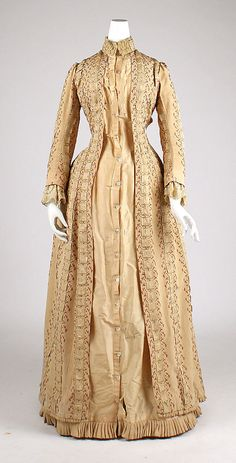 #1Tea gown   House of Worth (French, 1858–1956)  Designer: Charles Frederick Worth (French (born England), Bourne 1825–1895 Paris) Date: ca. 1880 Culture: French Medium: silk. Front