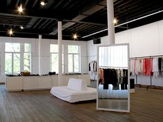 The minimalistic-white two-story boutique houses Ann Demeulemeester's complete his and hers collections. Interior Architecture, Interior Design, Weekend Deals, Ann Demeulemeester, Antwerp, Best Cities, Minimalist, Bed, Furniture