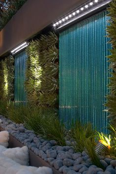 Green wall -vertical planting.   Or use on garage wall with ben siding stained blue color
