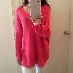 Coral oversized sweater Brand new. Beautiful soft and warm. Oversized fitting. This sweater has a deep V-neck. For reference I'm 5'4 wearing size S Sweaters