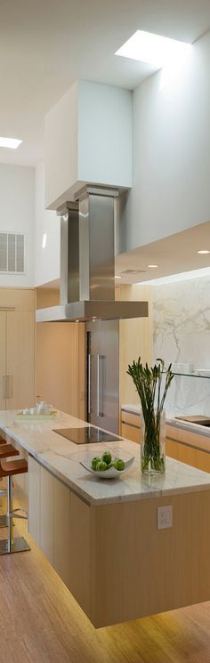 Beautiful modern kitchen...I love this kitchen. I would love to incorporate some of this design into my own kitchen!