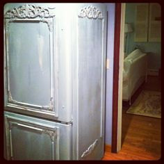 What a great idea! It looks like moulding was added too. old refrigerator painted with Annie Sloan paint