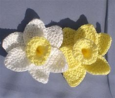 "Daffodils of Spring - Flower is about 5"" wide    Size F US/4.0mm crochet hook  Yarn needle   Caron Simply Soft acrylic yarn in white (petals) and yellow (cup)  center (make 1):  Ch 12, join to beginning to make a circle.  Sc in each of 12 chs. Do not join rounds, and work in a spiral instead, single crocheting in each stitch around until center piece is a tube about an inch long.  (sc, hdc, dc) in each stitch around for one round to make the ruffled edge. Tie off yarn and weave in ends."