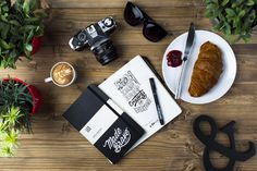 Typography creative flat lay photography by MadeBrave. Featuring Moleskine, coffee & Canon.