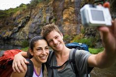Backpacker Couple Photographing Themselves