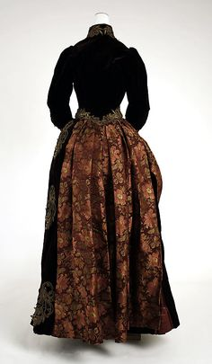 Walking dress, 1885-1890, silk and metallic thread, probably American. Back view.