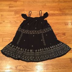 Free People brown tunic Frayed styling and embroidered details with capped sleeves and spaghetti strap shoulders. Free People Tops Tunics