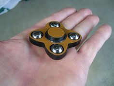"""New from JWraps - """"The Sion W"""" Fidget Spinner EDC Toy. Body is Solid Black Plastic with Gold Sparkle Vinyl Wrap - $22.95 plus $3.00 shipping  Crafted from High Density (HDPE) solid marine grade plastic and hand fitted bearings. Designed to last. NOT 3D printed - won't warp or break. Other wrap designs available. In stock, ready to ship! Purchase at our website: ohsnapproducts.com"""