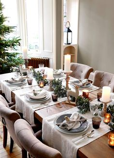 Christmas dining room ideas - Make your centerpieces shine - candlesticks, Christmas novelties and tealights complete a chic dining look for Christmas.