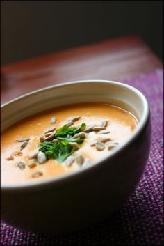 carrot cheese soup - made with Finnish processed cheese - recipe in Finnish (but - you grate the carrots, boil them soft in vegetable stock, add milk, some flour, processed cheese and enjoy. Decorate with roasted sunflower seeds and parsley.)
