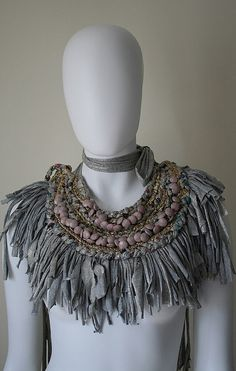Necklace created using reclaimed, recycled and vintage materials. Fused togther using different textile techniques.: