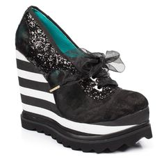 These sky high platform wedges featuring glitter uppers and striped rubber soles and the perfect party pair.