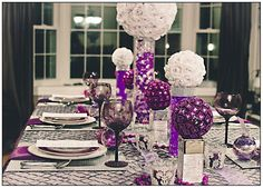 nice, purple, silver and white centerpieces, or change the colors! so chic for a holiday party!