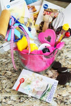 A Baker's Gift Basket - Spoons, whisks, rollers, measuring cups, basting brushes, cookie cutters, food thermometer, recipe books, mixing bowls, sprinkles, cupcake liners, anything!  To keep it girly and cute use some pink tissue paper in the mixing bowl and tie some ribbons around a few of the different items.  And of course a printable tag.