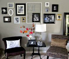 photo collage wall. Love the big frame around smaller frame--maybe with the big frame and smaller pics within it?