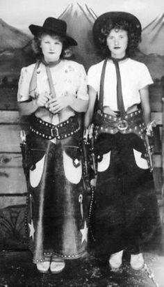 Vintage black and white photo of cowgirls.....
