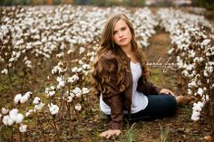 a senior session out on the cotton field
