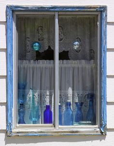 Blue Bottles In Blue Window Photograph