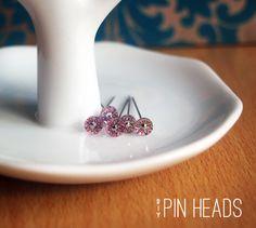 Custom pinheads.  Nice idea, but not exactly a speedy idea.