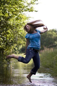 Senior girl, jumping in water