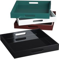 Shop hi-gloss square trays.   Handmade tray hosts a party full of noshes and drinks on a generously sized surface.  Cutout handles make it easy to carry from kitchen to crowd.