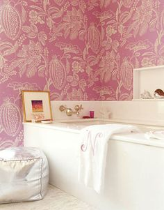 "This #master-bathroom, prettily wrapped in an overscale Manuel Canovas paper from Cowtan & Tout, is ""clean, feminine, and glamorous,"