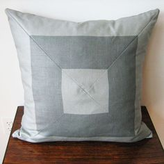 DIY four triangle pillow. Clever use of the stripe from Foley & Cox HOME creates the illusion of mitered corners. With careful cutting and matching, a smart striped home décor fabric takes on a novel contemporary style when stitched into a mitered designer pillow. Select a favourite striped fabric and coordinate the colours with your home décor for this easy DIY project.