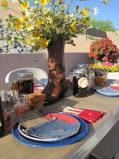 Cowboy- love the denim pockets for menu holders, the mason jars and LOVE the daisies in a boot on the table! Handkerchief napkin too!