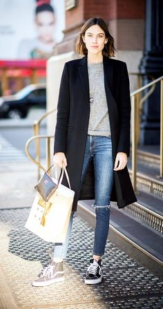The ultimate weekend uniform—jeans, sneakers, a tee, and an oversized coat.