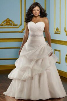 Plus size wedding dress, wedding gown for the full figured or curvy woman. Flattering and slimming layers