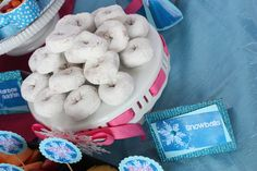 "Powdered donut ""snowballs"" at a Frozen girl birthday party!  See more party ideas at CatchMyParty.com!"